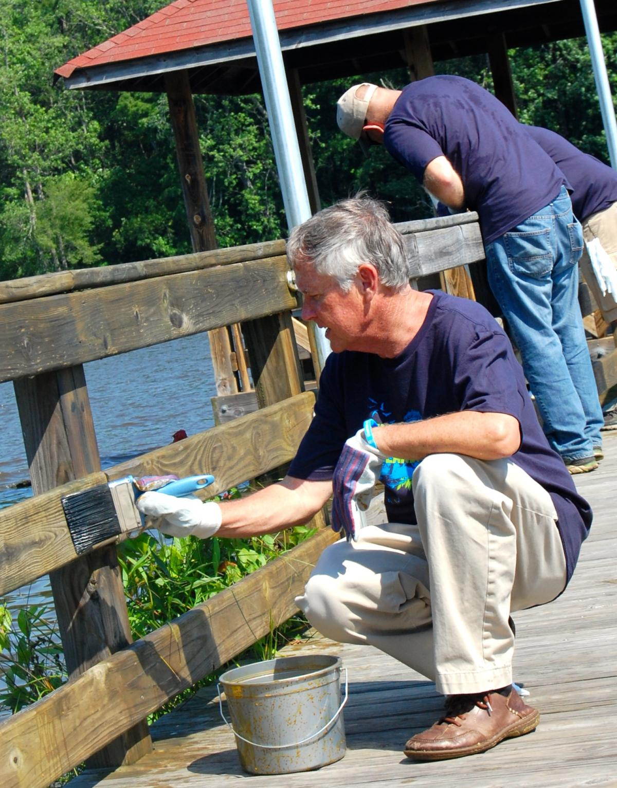 SCA volunteers help reseal the boardwalk in historic Plymouth, North Carolina