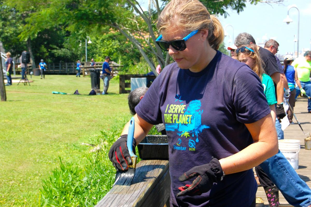 Domtar volunteers paint the boardwalk in historic Plymouth, North Carolina