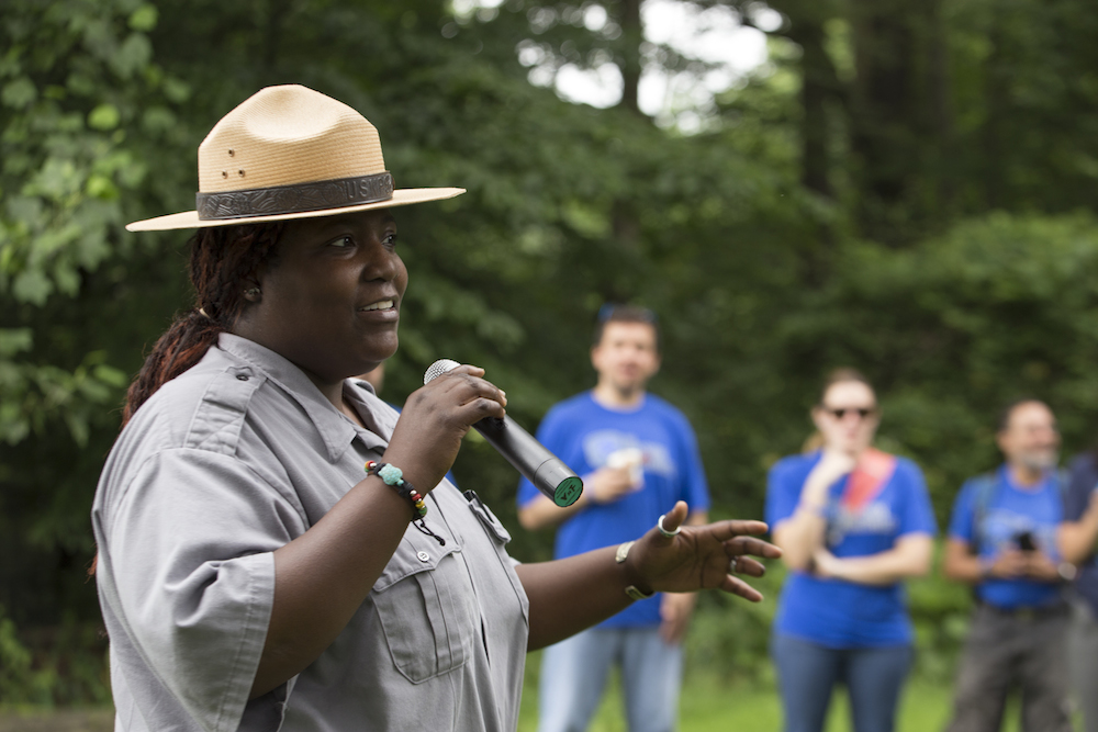 NPS Ranger Kenya greets SCA volunteers at Fort Dupont Park