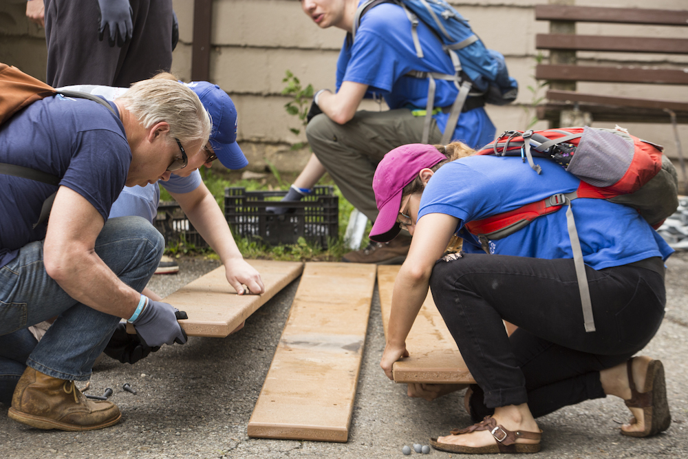 SCA volunteers construct picnic tables at Fort Dupont Park