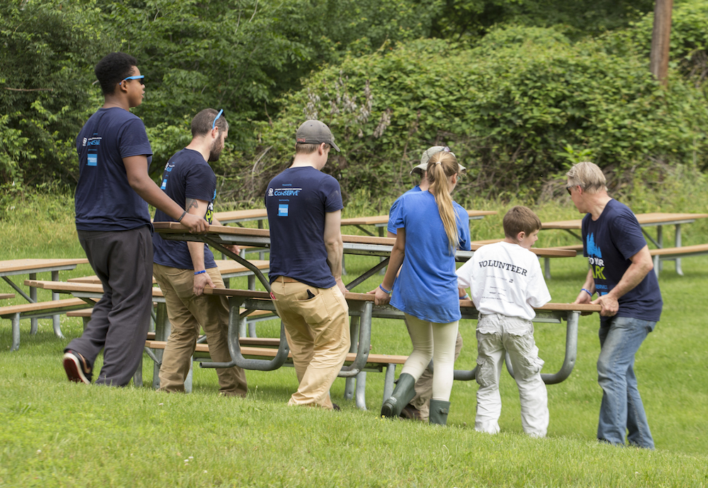 SCA volunteers place newly-constructed picnic tables at Fort Dupont Park