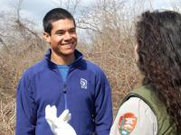 An SCA intern talks to a National Parks Service ranger at Gateway National Seashore