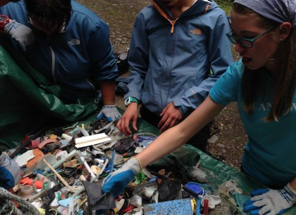 Sorting small pieces of photo degraded plastic by hand, NOAA bound.