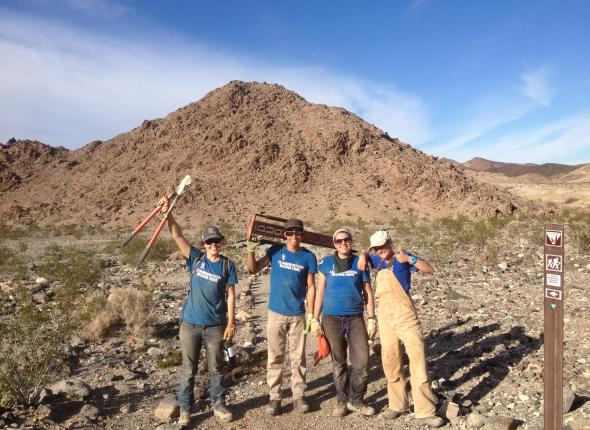 Wild50 team at the entrance of the newly re-opened trail.