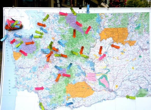 Visitors mark their favorite parks on a map for National PARKing Day
