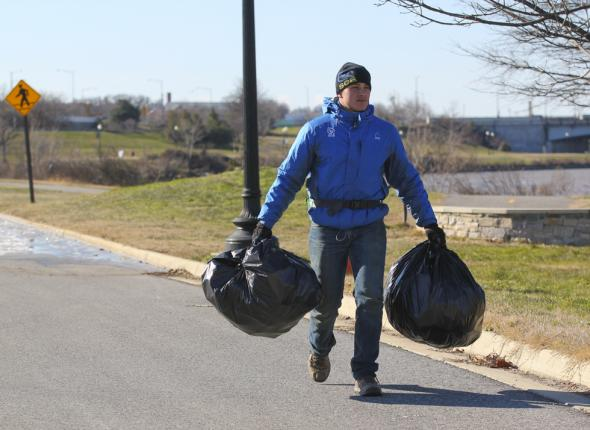 SCA leader Jeremy clears trash from the Anacostia River