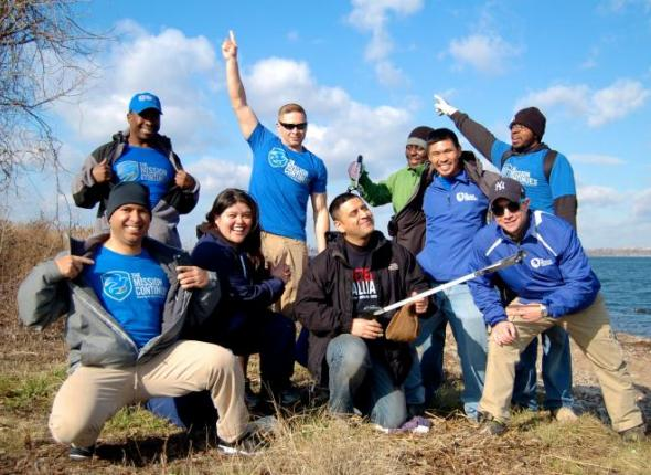 US veterans from The Mission Continues volunteers at SCA's Find Your park beach cleanup in NYC