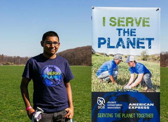 Imran Khan, an SCA volunteer, serving during Earth Day 2015 at Van Cortlandt Park in the Bronx, New Yorlk