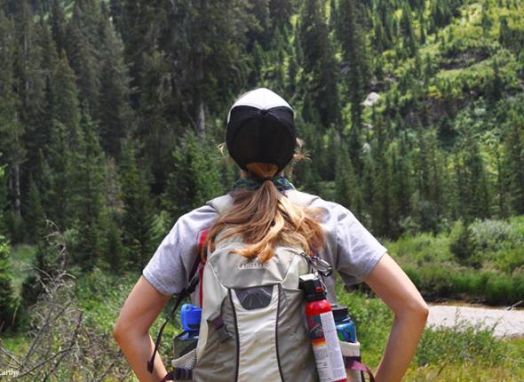 Hiker admiring the Tetons by Allyson McCarthy.