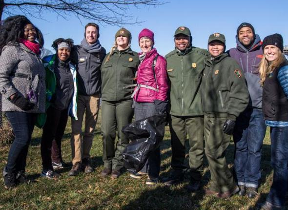 SCA Alum Roland Richardson, pictured second from right, spoke to the hundreds of volunteers gathered for a day of service at Anacostia Park