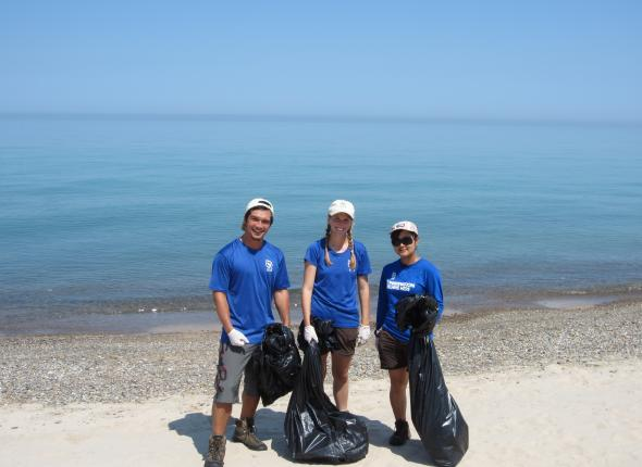 Picking up trash by Lake Michigan