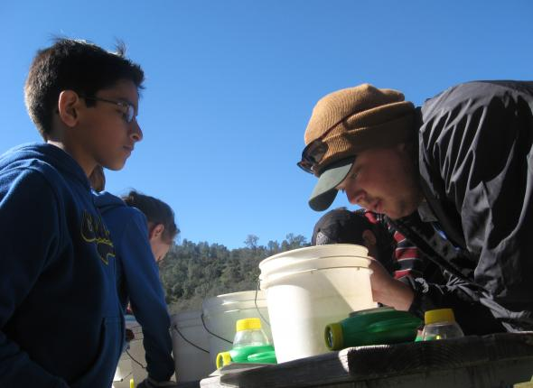 Ben helps fifth grade students identify aquatic invertebrate indicator species.