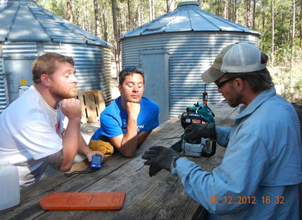 Project Leader, Bobby Woelz, reviews proper Chain Saw maintenance with the team.