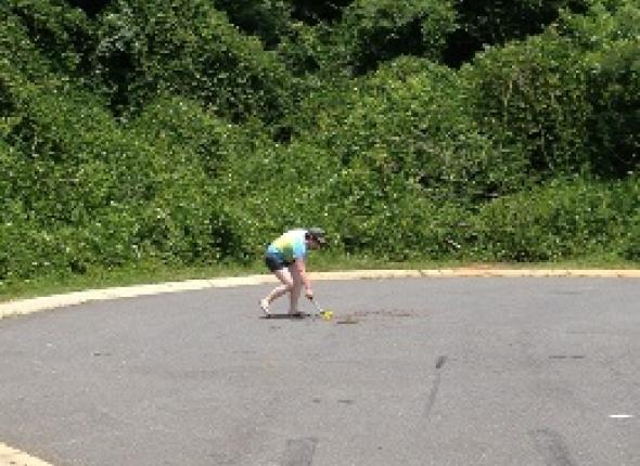 Clare measuring a cul-de-sac in one of our many neighborhood assessments.