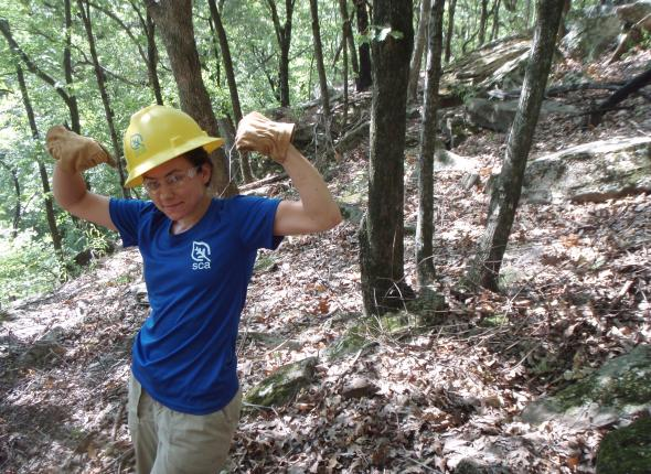 Abby showing off part of her pile of fencing during a trail build at Fort Gibson Lake.