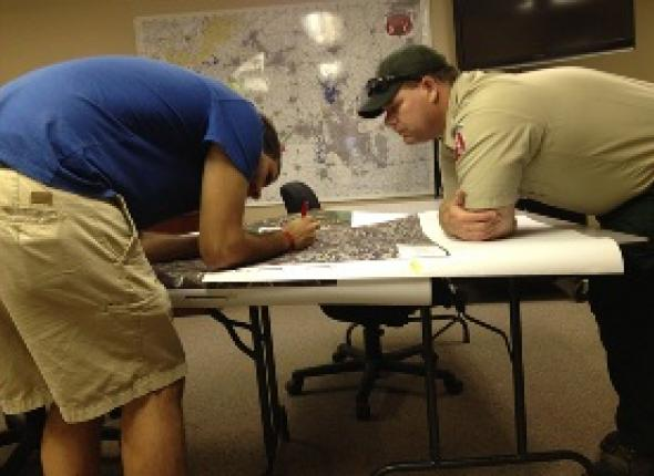 Mike working on maps with agency partner Eddie Reese.