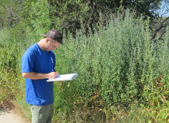 Ryan notes a bench on his clipboard, Boyer Chute NWR