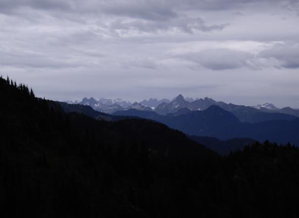 The spires of the Pickett Range stab the overcast sky.