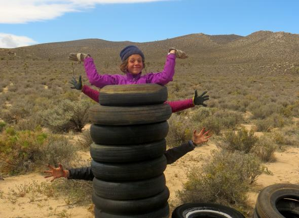Grace and a collection of tires collected in Jawbone.