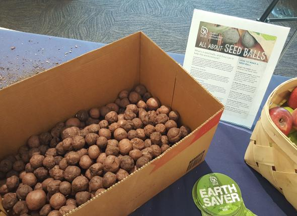 Volunteers make seed balls using native wildflower seeds from American Meadows.