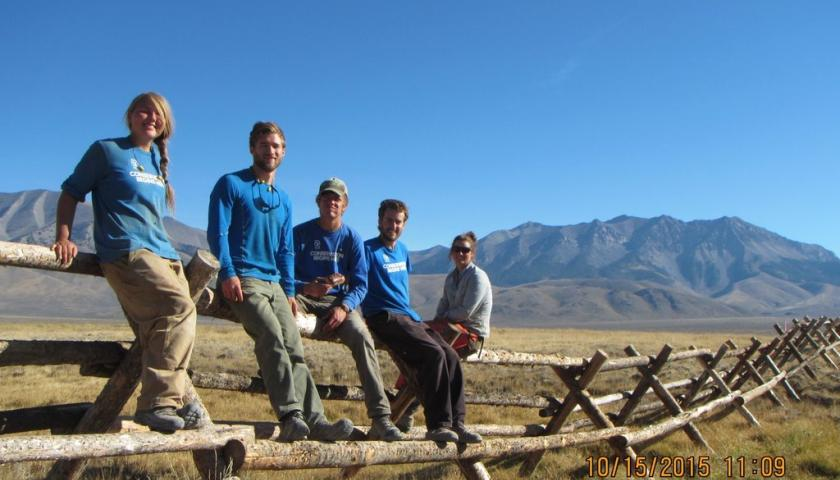 SCA Crew in Chilly Slough Wetlands sitting on the Jack leg fence they just completed.