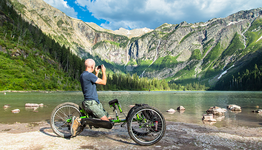 A park visitor uses an off-road wheelchair in Glacier National Park.
