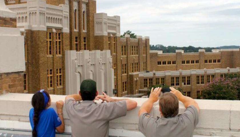 SCA Centennial Volunteer Ambassador Sally Goldman surveys Little Rock Central High with NPS staff