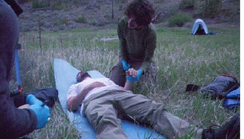 Asher Hudson, SCA Idaho, tending to a patient during a mock scenario.
