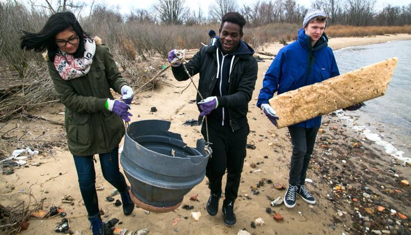 Volunteers gather storm debris along Jamaica Bay