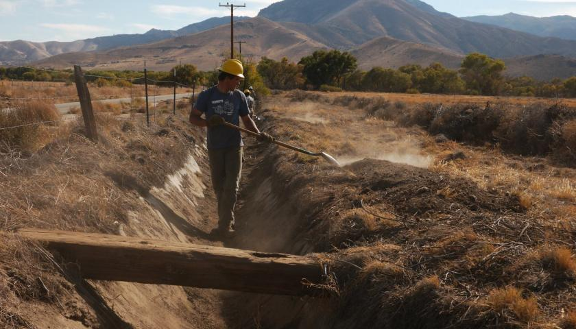 Former conservation volunteer and SCA Leader Crew member Caleb Sanders works on an irrigation ditch as part of a major ecosystem restoration project in California's Southern Sierra Nevadas.