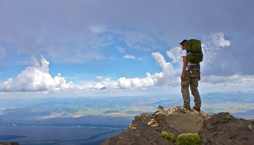 Carlos A De La Torre, SCA member, high above the mountains