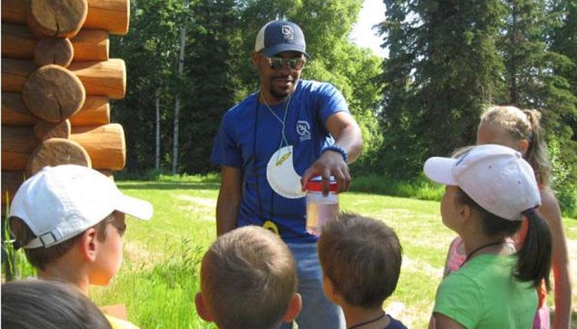 SCA Member William Moore III working with kids at Kenai National Wildlife Refuge