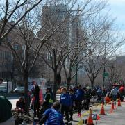 SCA Volunteers cleaning up green space for Earth Day in New York City