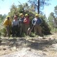 The Team poses in front of one of their many piles. (Left to Right): Davon, Bobby, Brian, Eric, & James.